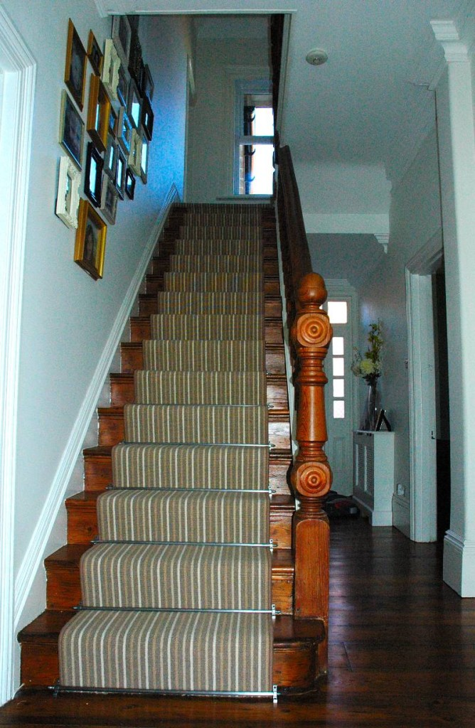 A beautiful staircase that makes use of a runner and stair rods. Source: http://www.trickpod.net/stair-carpet/40/stair-runner-carpet-fitting-to-straight-stairs-with-stair-rods/
