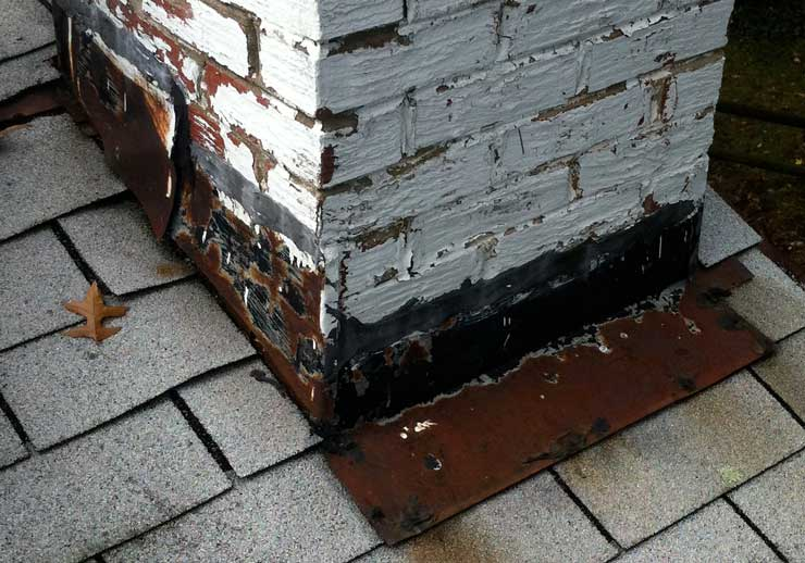 Examine the corners and joints of the roof carefully - here, the metal flashing around a chimney has badly rusted. Source: Lyons Contracting